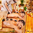 Woman and man getting stone therapy massage in spa. — Stock Photo