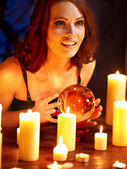 Woman holding scrying ball . — Stock Photo