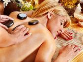 Woman getting stone massage . — Stock Photo