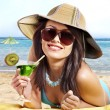 Stock Photo: Girl in bikini drinking alcohol coctail through straw.