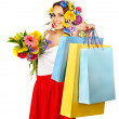 Stock Photo: Woman with shopping bag holding flower.