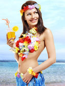 Woman in hawaii costume drink juice. — Stock Photo