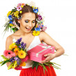Woman with gift box and flower. — Stock Photo #21380921
