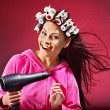 Woman wear hair curlers on head. — Stock Photo #21380939
