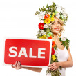 Woman holding sale banner and flower. — Lizenzfreies Foto