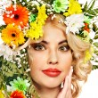 Stock Photo: Woman with make up and flower.