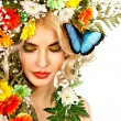 Woman with butterfly and flower. — Stock Photo