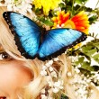 Woman with flower and butterfly. — Stockfoto