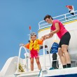 Happy family with child on yacht. - Stock Photo