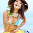 Girl in bikini drink juice through a straw. — Stock Photo #22213737