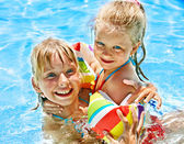 Kids with armbands in swimming pool. — Stock Photo