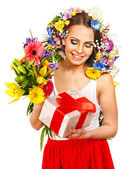 Woman with gift box and flower bouquet . — Stock Photo