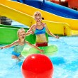 Child on water slide at aquapark. — Stock Photo #22899094
