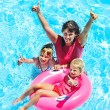 Family in swimming pool. - Stock Photo