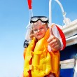 Happy child on yacht. - Stock Photo
