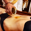 Woman having Ayurvedic spa treatment. - Stock Photo