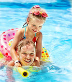 Children sitting on inflatable ring. — Stock Photo