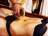 Woman having Ayurvedic spa treatment. — Stockfoto