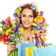 Woman with shopping bag holding flower. — Stock Photo #22901176