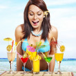 Girl in bikini on beach drinking cocktail. — Stock Photo #22903352