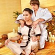 Male masseur doing massage woman in bamboo spa. — ストック写真