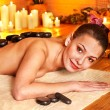 Royalty-Free Stock Photo: Woman getting stone therapy massage in bamboo spa