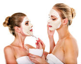 Woman getting facial mask. — Stockfoto