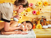 Woman getting herbal ball massage. — Стоковое фото