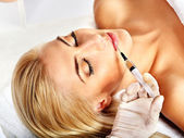 Doctor woman giving botox injections. — Stock Photo