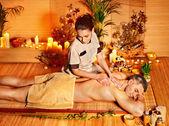 Woman getting bamboo massage. — Stock Photo