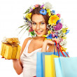 Woman with shopping bag holding flower. — Stok fotoğraf