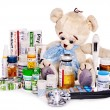 Child medicine and teddy bear. — Stock Photo #23311406