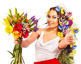 Woman with flower bouquet thumb up . — Stock Photo
