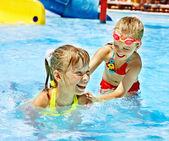 Children on water slide at aquapark. — Stock Photo