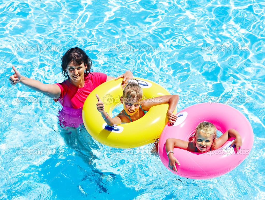 Family in swimming pool stock photo poznyakov 23310754 for Family swimming pool