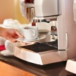 Coffee machine with cup of coffee . - Stock Photo