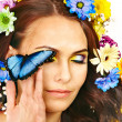 Woman with flower and  butterfly. - Stock Photo