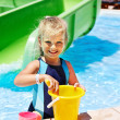 Royalty-Free Stock Photo: Child with bucket in swimming pool.