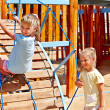 Постер, плакат: Children move out to slide in playground