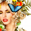 Woman with butterfly and flower. - Stock Photo