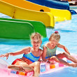 Child on water slide at aquapark. — Stock Photo #23674385