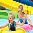 Child on water slide at aquapark. — Stock Photo #23674413