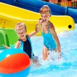 Child on water slide at aquapark. — Stock Photo #23674441