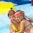 Children on water slide at aquapark. — Stock Photo #23674577