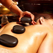 Woman having Ayurvedic stone massage. - 图库照片