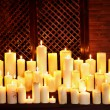 Group lighted candle in spa salon. - Stock Photo
