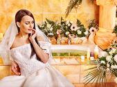 Woman wearing wedding dress. — Stock Photo