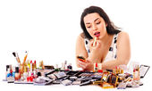Girl applying makeup. — Stock Photo
