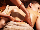 Woman having Ayurvedic spa treatment. — Stock Photo