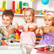 Children sculpt in of plasticine - Stock Photo